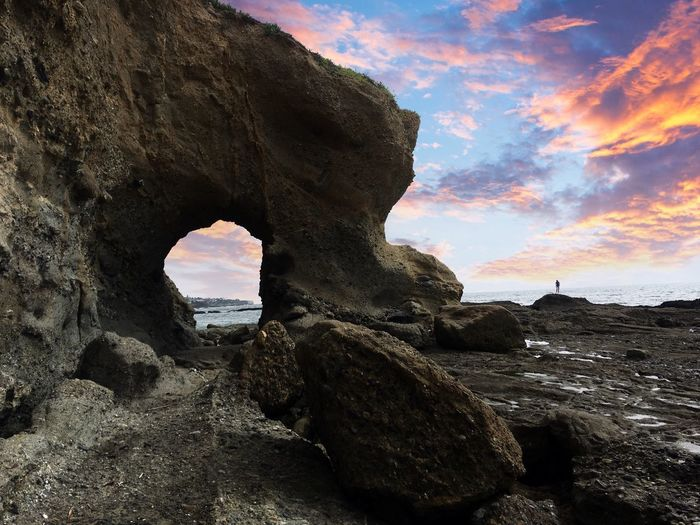 No man is an island My Best Photo Nature Beach Man Landscape Rock Sky Rock - Object Solid Rock Formation Nature Cloud - Sky Natural Arch Tranquil Scene Sunset Scenics - Nature Beauty In Nature