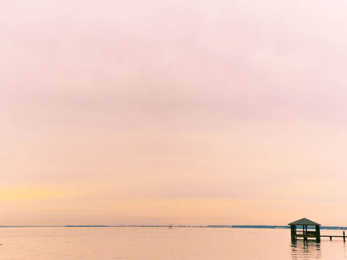 Water Sky Sea Sunset Beauty In Nature Scenics - Nature Built Structure Nature No People Horizon Horizon Over Water Waterfront Pink Color