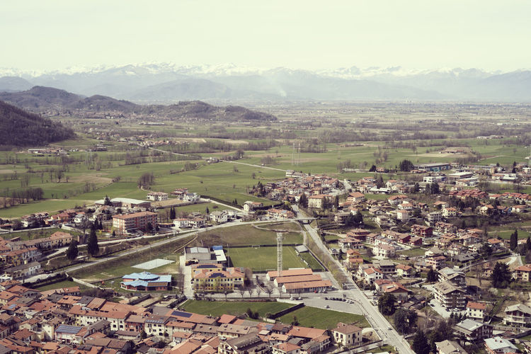 Panorama on a city of Piedmont (Italy) Cityscape Architecture High Angle View Building Exterior Built Structure Building Landscape Environment City Mountain Residential District Town Rural Scene Sky Scenics - Nature Outdoors TOWNSCAPE Land Day No People Field Piemonte Landscape_Collection EyeEm Best Shots Italy