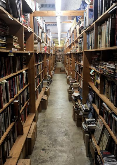 Depths of a used books store. Used Bookstore Used Books Vertical Bookshelf Shelf Book Library Indoors  Large Group Of Objects In A Row Literature Bookstore Education Abundance Stack Research Information Medium