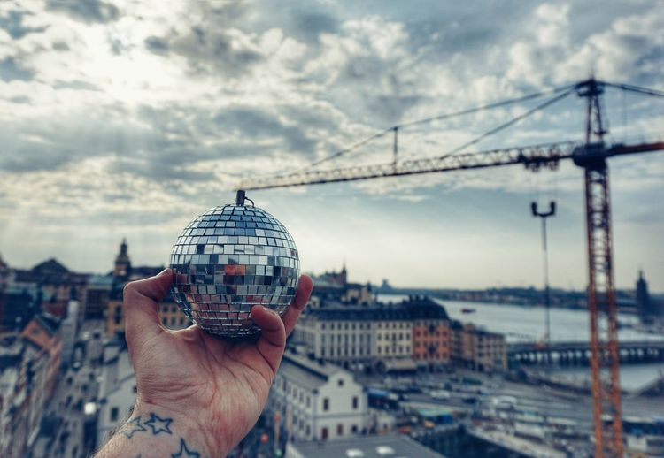 When you try to make Stockholm a bit more disco! Disco Ball 2019 Niklas Storm April Human Hand Cityscape City Technology Men Sky Close-up Architecture Tall - High Urban Skyline Personal Perspective Visiting Exploring Fun My Best Photo Springtime Decadence