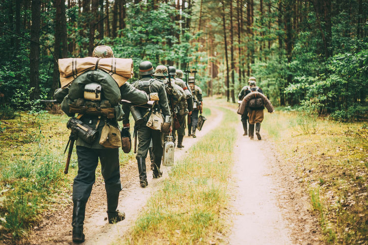 Unidentified re-enactors dressed as German soldiers during march through summer forest War Ww2 WWII Ww1 Front Army Soldier Millitary Forest Uniform German Road Ussr Re-enactors March