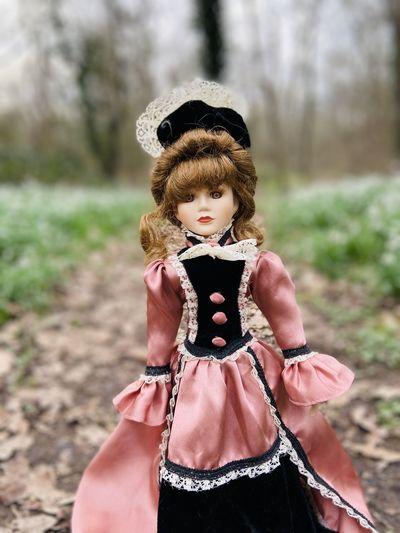 Girl wearing hat standing on field