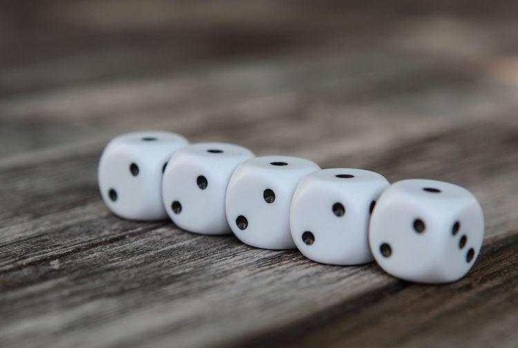 10 Spotted All Line In A Row Arts Culture And Entertainment Cube Shape Dice Gambling Game Of Chance Leisure Activity Luck Number Opportunity Relaxation Row Selective Focus Spotted Table Ten Wood - Material