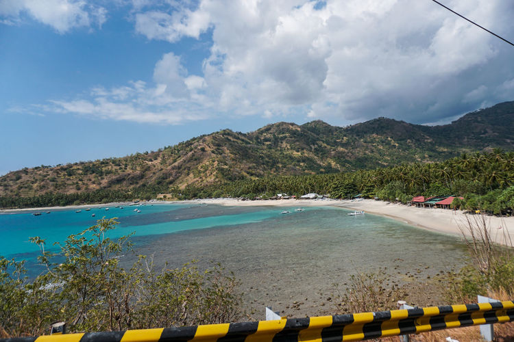 Indonesia, Lombok Island West Nusa Tenggara (NTB), on Sunday (5/8/2018) at around 6:46 p.m., the earthquake with a strength reached 7.0 on the Richter Scale (SR). The photo was taken 3 days after the earthquake along the road to North Lombok which suffered the worst damage. residents make emergency tents along the main road and wait for government assistance and donations from volunteers. the situation in Lombok is still severe, making traffic jams everywhere, scrambling for help to survive. Sky Water Cloud - Sky Mountain Nature Beauty In Nature Scenics - Nature Day Sea Nautical Vessel Plant Tranquility Tranquil Scene No People Transportation Non-urban Scene Yellow Mountain Range Outdoors Earthquake Earthquake Area Lombok Lombok-Indonesia Lombok Island INDONESIA