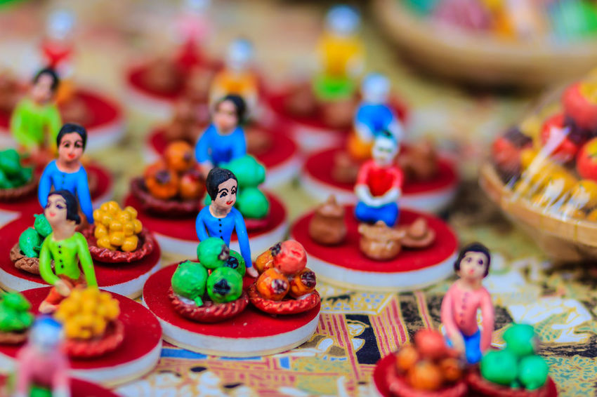 Cute Clay Dolls of Thai Culture, Selective Focus Clay Doll Doll Cute Clay Dolls Thai Doll Art And Craft Clay Doll Clay Dolls Close-up Creativity Day Figurine  Food And Drink Indoors  Multi Colored No People Selective Focus Table Thai Children Thai Cultural Thai Culture