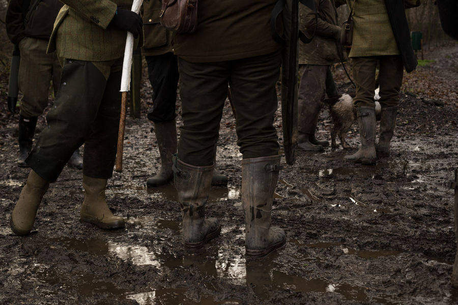 Waiting in the mud Dirty Footwear Friendship Human Leg Leisure Activity Lifestyles Low Section Men Messy Wellies Mud Muddy Outdoors Real People Shoe Standing Togetherness Wellies  Wellington Boots Wellingtons Shooting Shoot Country Life