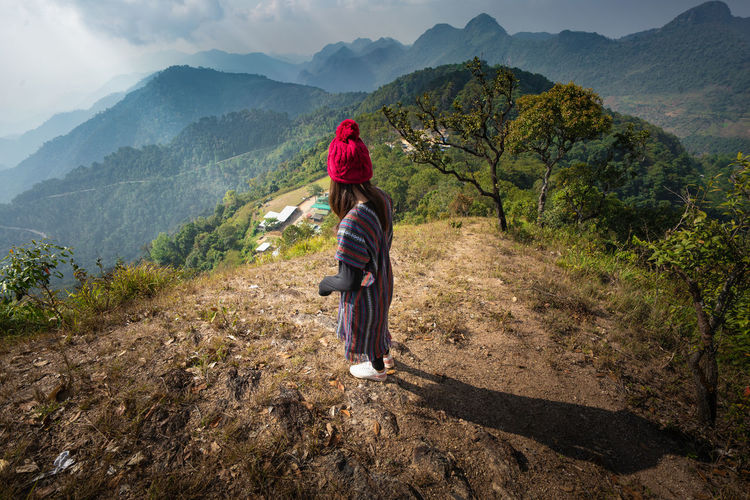 Full length of woman standing on mountain