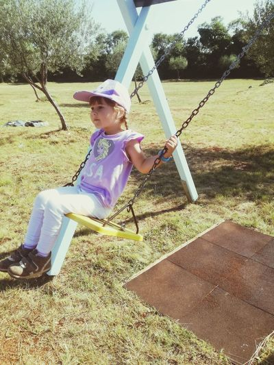 Childhood Playground Child Children Only One Person Boys Casual Clothing Playing Swing Outdoor Play Equipment Day Leisure Activity Full Length Elementary Age Outdoors Girls One Boy Only Real People People