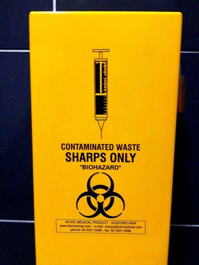 Syringe Syringes Sharps Sign SharpsOnly Disposal Safe Black And Yellow  Biohazard Contaminated Waste Contaminated Contaminated Medical Waste Medical Waste SHARPS ONLY Yellow Communication Close-up Information Western Script Text