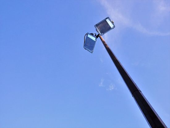 Low Angle View Outdoors Halogen Lamps Halogen Lights Illumination Blue Sky Looking Up