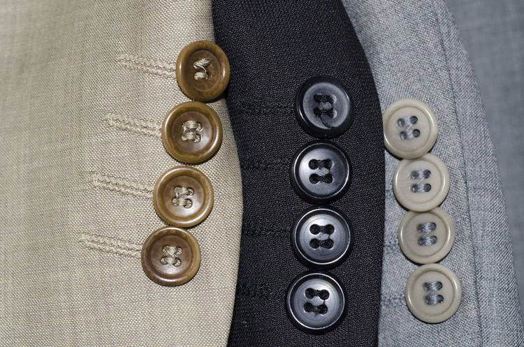 Suit sleeves with buttons Apparel Attire Business Business Finance And Industry Businessman Button Close Up Close-up Clothes Colors Fashion Gentlemen Jacket Lapel Material No People Part Of Sleeves Suit Suit Sleeves Textile Textile Design Textile Industry Three Colors Wardrope