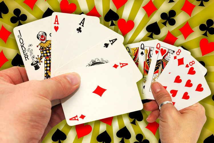 Cropped Hands Holding Cards