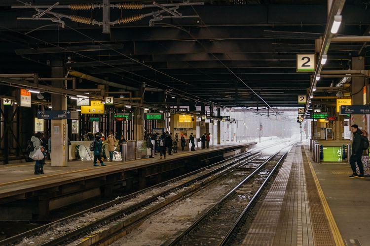 People at railway station at night