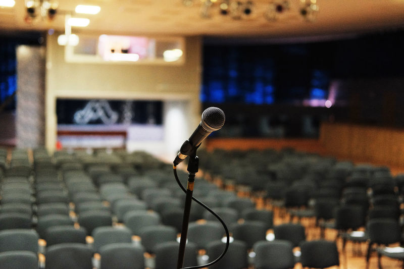 Close-up of microphone in empty lecture hall