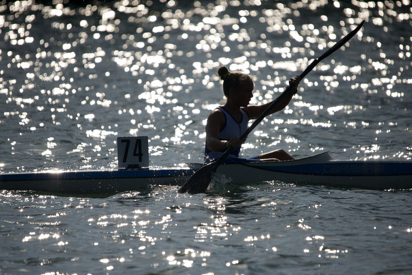 boating competition Boating Competition Lighting Oar One Person Outdoors Portrait Of A Woman Rowboat Rowing Sea Silouette And Shadows Sport Water Acquatic Sport Sea Life Summertime Travel Pictures EyeEmNewHere Press For Progress