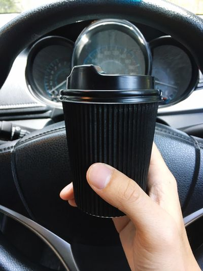 Coffee Time Car Transportation Human Hand Mode Of Transport Vehicle Interior Land Vehicle Car Interior Human Body Part Holding One Person Real People Close-up Day Adult People Coffee Cup Coffee