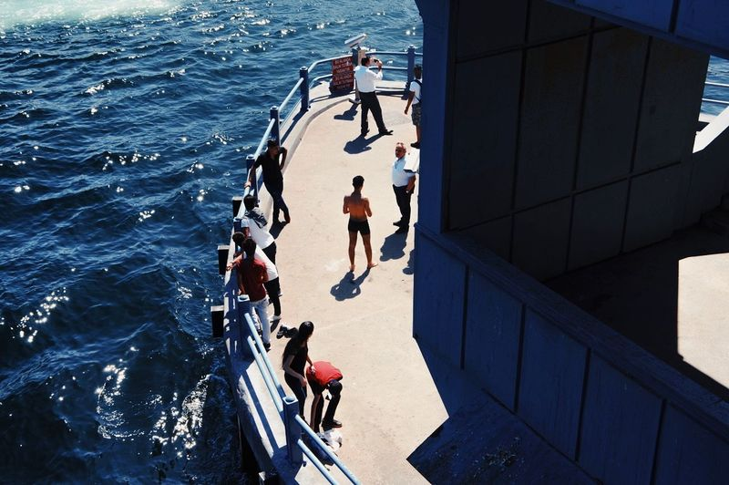 High Angle View Sunlight Day Togetherness Outdoors People Water Men Sea City Young Adult Real People Multi Colored Swimming Urban Photography Life Art Is Everywhere The Week Of Eyeem The Week On Eyem Travel Destinations Streetphotography Istanbul Bridge - Man Made Structure Breathing Space Group Of People