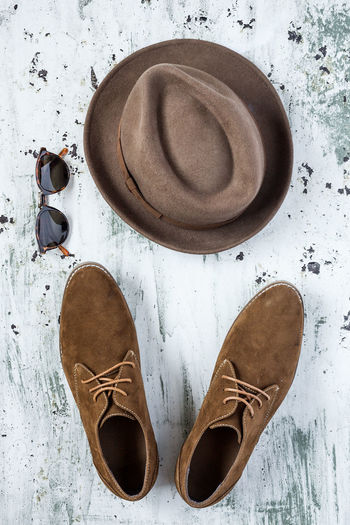 High angle view of shoes and hat on table