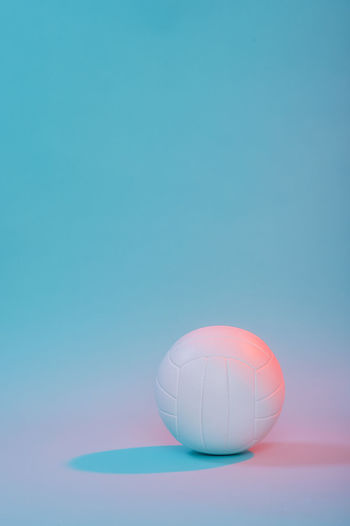 Close-up of volleyball over colored background