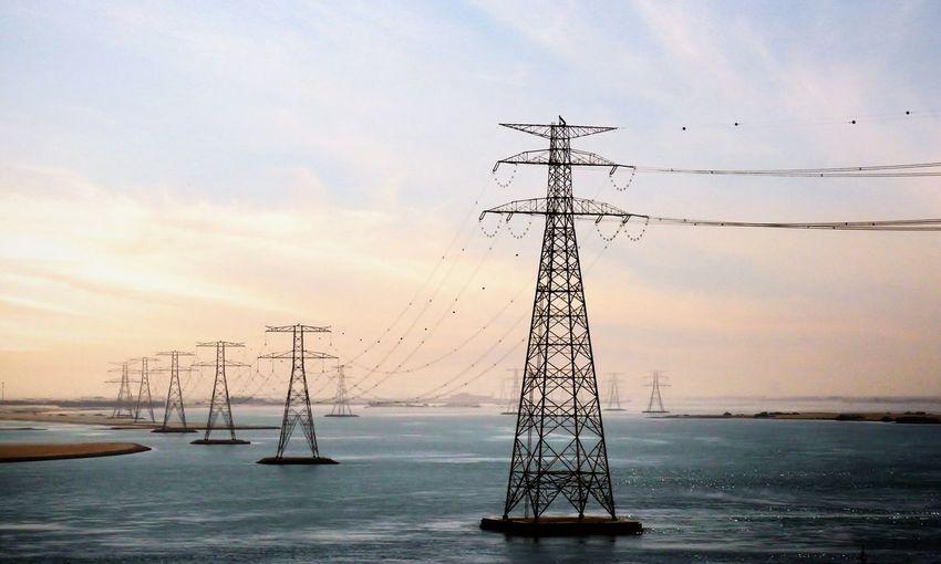 Power lines against sky