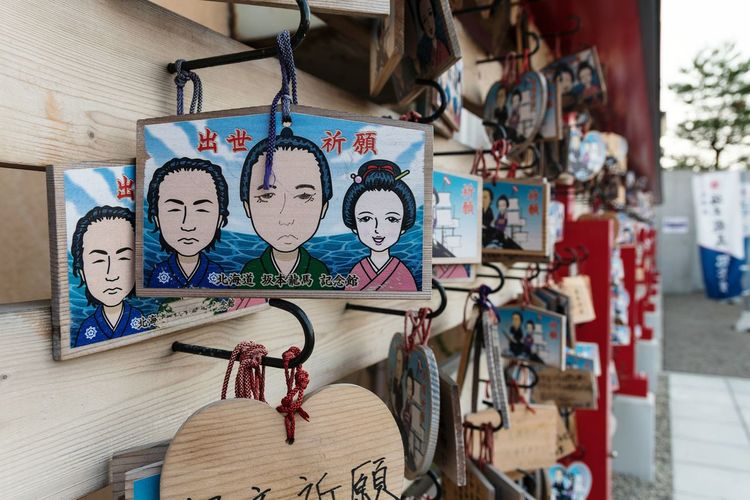 EyeEm Selects Hanging Art And Craft Building Exterior Built Structure Day Architecture Multi Colored No People Luck Outdoors Painted Image Close-up Shinto Shrine Ema Tablets Hakodate Hokkaido Japan