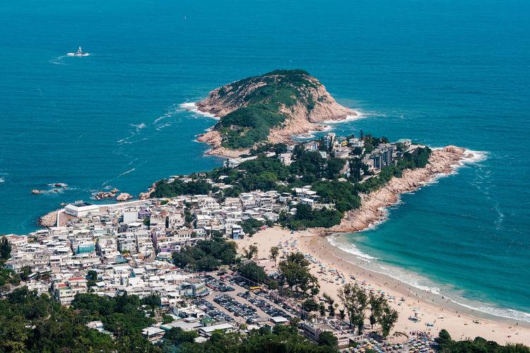 Houses at the coastline of dragon  back, hong kong