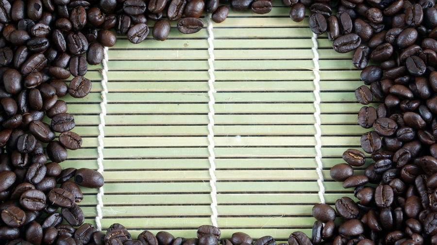 Dark roasting coffee beans on bamboo. Aroma Bakery Beans Boiler Business Cafe Cappuccino Chocolate Christian Coffee Cookies Cream Drink Espresso Latte Latte Art Milk Morning Pressure Roasting Robust Stream Sweet Tables Wood
