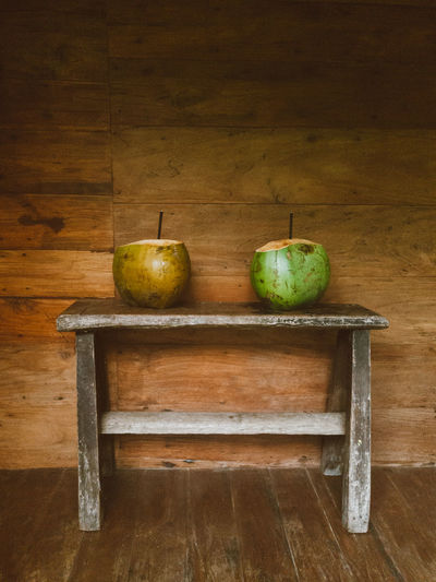 Fruits on table against wall