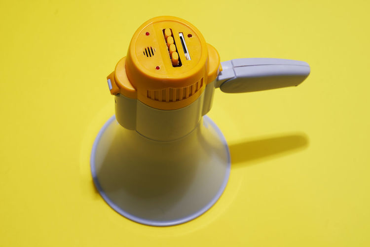 High angle view of toy on table against yellow background