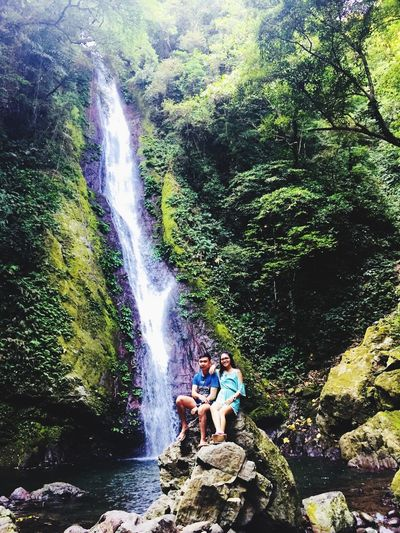 Trekking to one of the most beautiful waterfalls I have seen, the Kabigan Falls in Pagudpud Ilocos Norte with my love. Discovered the cold, clean and clear waters. The Journey towards the hidden paradise made us realize that we can finish any journey in life successfully as long as we are together. #siamdiscovery #godiscoversummer #thejourney #mylove Water Real People Motion Tree Nature Waterfall Summer Exploratorium