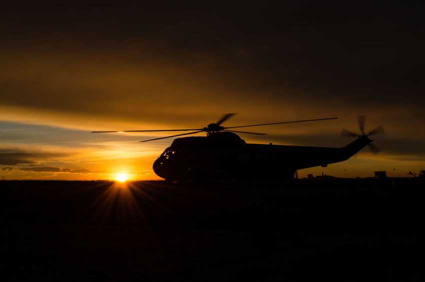 Sea king helicoper silhouette during sunrise War Rescue Flight Fly Day Dramatic Sky Military Life Sunset Horizon Night Sunrise Sun Helicopter Landscape Sikorsky Chopper Blade PilotsLife Copilot Pilot Fly Rotor Yellow Red Horizon Uh3h Sea King Military Flight Sun