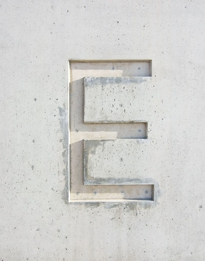 The letter 'E' cut in grayish white stone design element Alphabet Close-up Concrete Day Enjoying Life Letter Letter E No People Outdoors