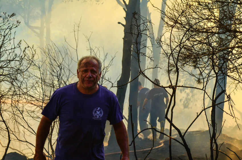 Firefighter after a day of putting out a forest fire in Lebanon Burning Burning Wood Disaster Fire Fireman Firemen Forest Forest Fire Lebanon Natural Disaster Non-urban Scene Pain Smoke People And Places