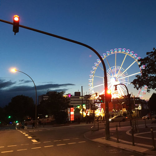 View of illuminated street lights against clear sky