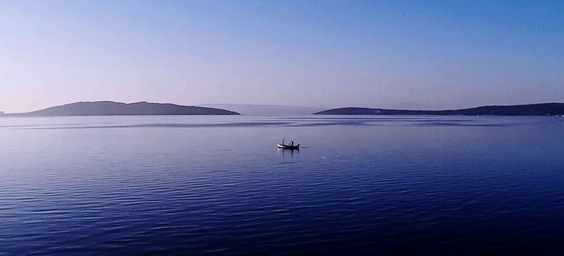 Small fishing boat in the sea Small Boat Fishing Boat Sea Boat Tranquility Early Morning Sea And Islands Blue Sea Bonazza Bonaza Quiet Sea Boat Fishing Adriatic Sea Jadranskomore Croatia Feel The Journey Original Experiences Aerial Shot Aerial Photography Alone In The World The Innovator