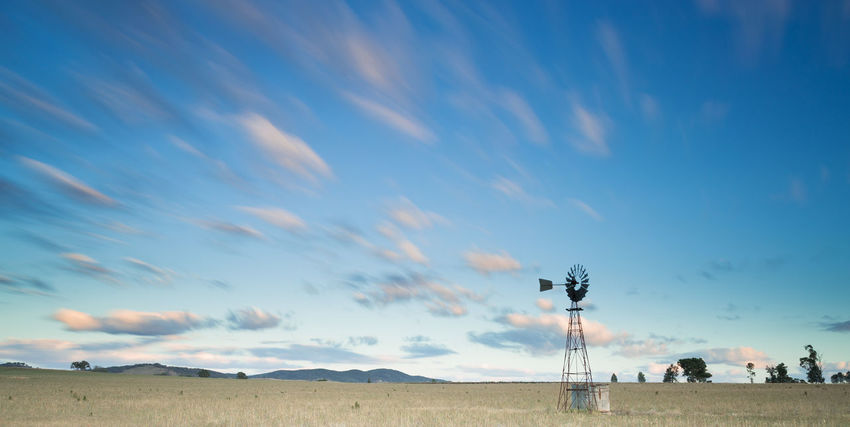 Astronomy Beauty In Nature Cloud - Sky Clouds Day Early Morning Hanging Out Landscape Moving Clouds Nature No People Outdoors Paddock Scenics Sky Star - Space Sunset Technology Tranquility Tree Trees On The Horizon Windmill