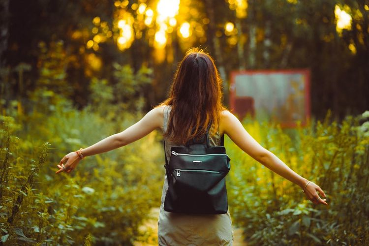 Adult Adults Only Beauty Beauty In Nature Grass Happiness Leisure Activity Lifestyles Long Hair Nature Night One Person One Woman Only One Young Woman Only Only Women Outdoors People Real People Rear View Standing Three Quarter Length Tree Women Young Adult Young Women