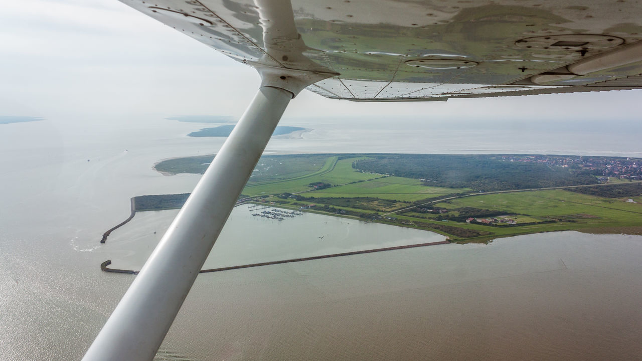water, scenics - nature, environment, landscape, airplane, air vehicle, transportation, beauty in nature, mode of transportation, aerial view, vehicle interior, nature, day, no people, travel, flying, sky, outdoors, window