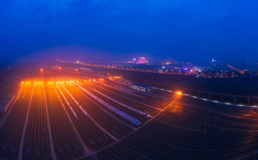 Railway, city, high-speed rail, travel Travel Train Train Station Outdoors No People Sky High-speed Rail City Cityscape City Lights Railway Night Nightlife Illuminated Motion Long Exposure Transportation Architecture Light Trail Blue Building Exterior Lighting Equipment Road Light - Natural Phenomenon City Life Light High Angle View Speed Traffic