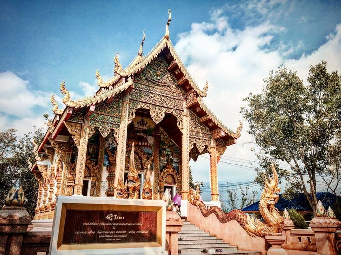 Golden church Architecture Religion Built Structure Travel Destinations Spirituality Outdoors Thai Temple Phrathatdoikhamtemple Thailand_allshots Thailand Chiangmai Watphrathatdoikham Adayinthailand Travel Buddhist Peace Buddhist Temple Thailandtravel Thai Art Thai Architecture