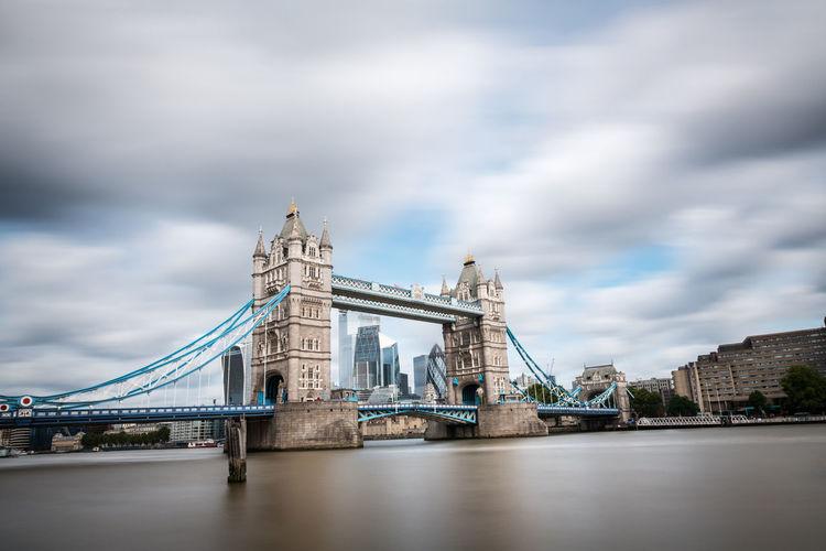 Tower bridge and modern skyscrapers in london.