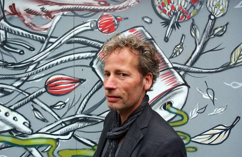 Portrait Of Man Standing Against Graffiti Wall