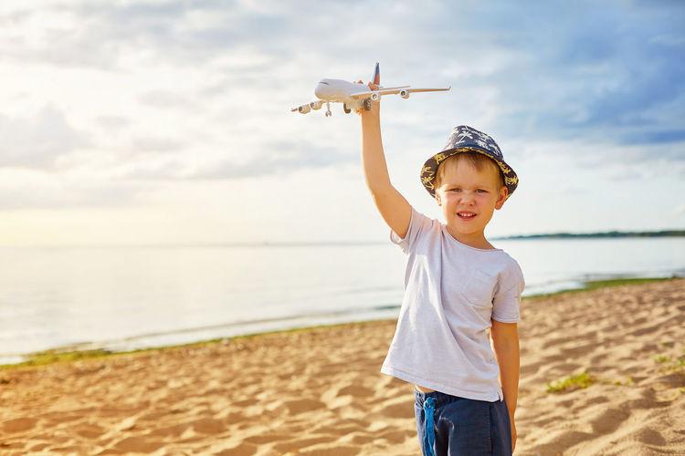 Portrait of boy standing on beach