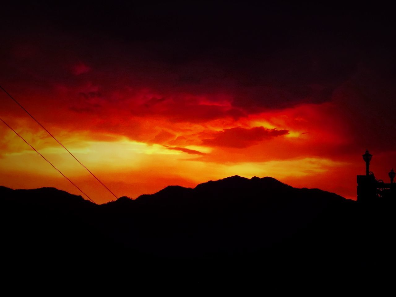 sunset, silhouette, orange color, nature, beauty in nature, sky, scenics, outdoors, no people, tranquil scene, tranquility, mountain, flame