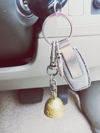 Close-up of key chain in car