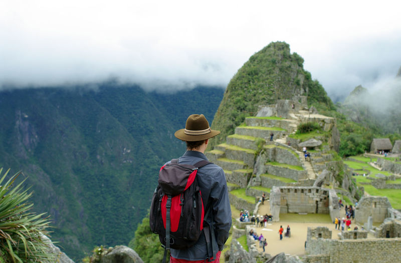 Looking at the Machu Picchu Ancient Architecture Cusco Imperial Inca Lost Machu Picchu Peru Travel UNESCO World Heritage Site Wall Ancient Civilization Antic Beauty In Nature Civilization Day Fog Holiday Leisure Activity Looking At View Men Mountain Mysterious Nature Outdoors People Real People Rear View Scenics - Nature Sky South America Tourism Tourist Travel Travel Destinations Trip Vacations Waynapicchu Wonder Of The World The Traveler - 2018 EyeEm Awards Redefining Menswear