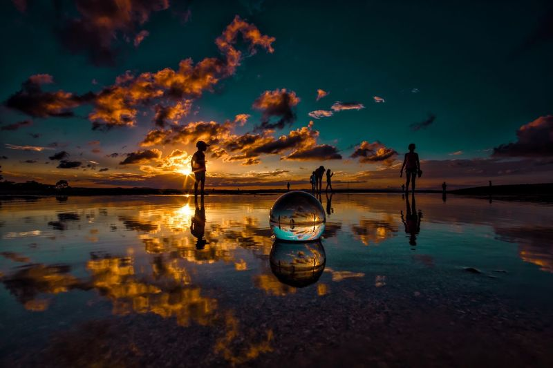Sunset with the lensball Dramatic Sky Water_collection Peaceful Water Reflections Landscape_photography EyeEm Best Shots Lensball Silhouette Water Sky Sunset Reflection Cloud - Sky Sea Beauty In Nature Scenics - Nature Beach Nature Land Tranquility Tranquil Scene