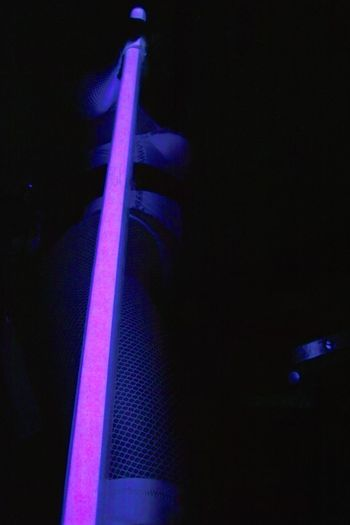 Close-up of a guitar playing in the dark