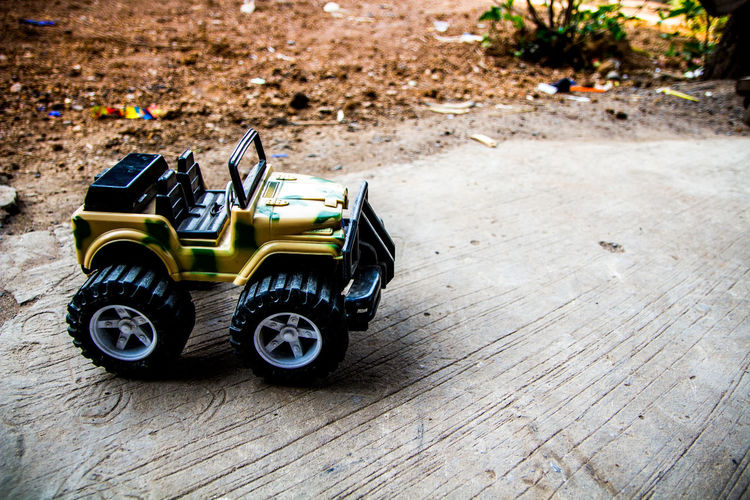Toy Toy Car Transportation Childhood Day Mode Of Transportation High Angle View Wood - Material Car Still Life Focus On Foreground Wheel Land Vehicle Outdoors Flooring Sunlight Close-up Sport Nature Small Tire Auto Racing